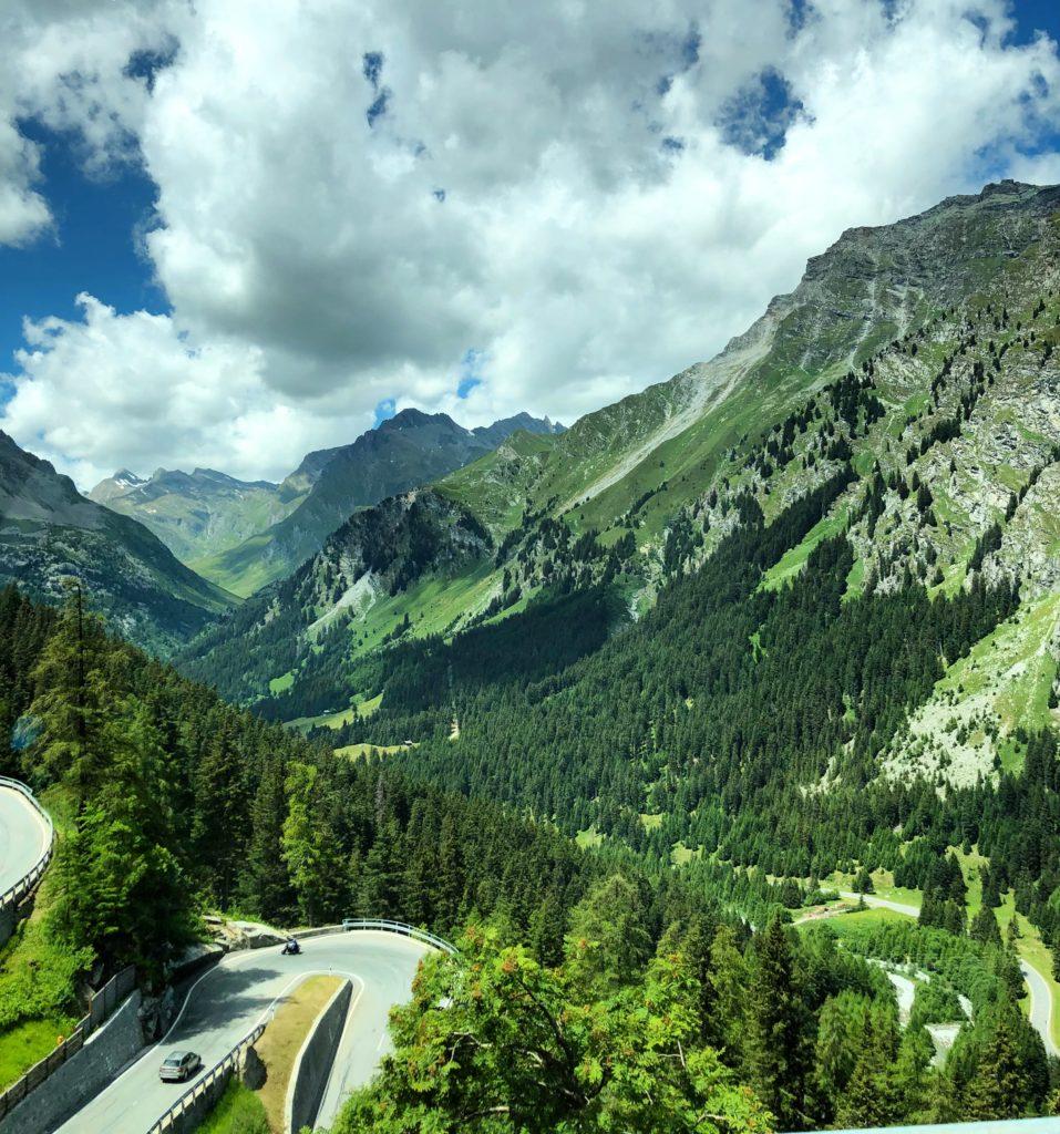 Breathtaking views and super curvy road near St. Moritz in Switzerland