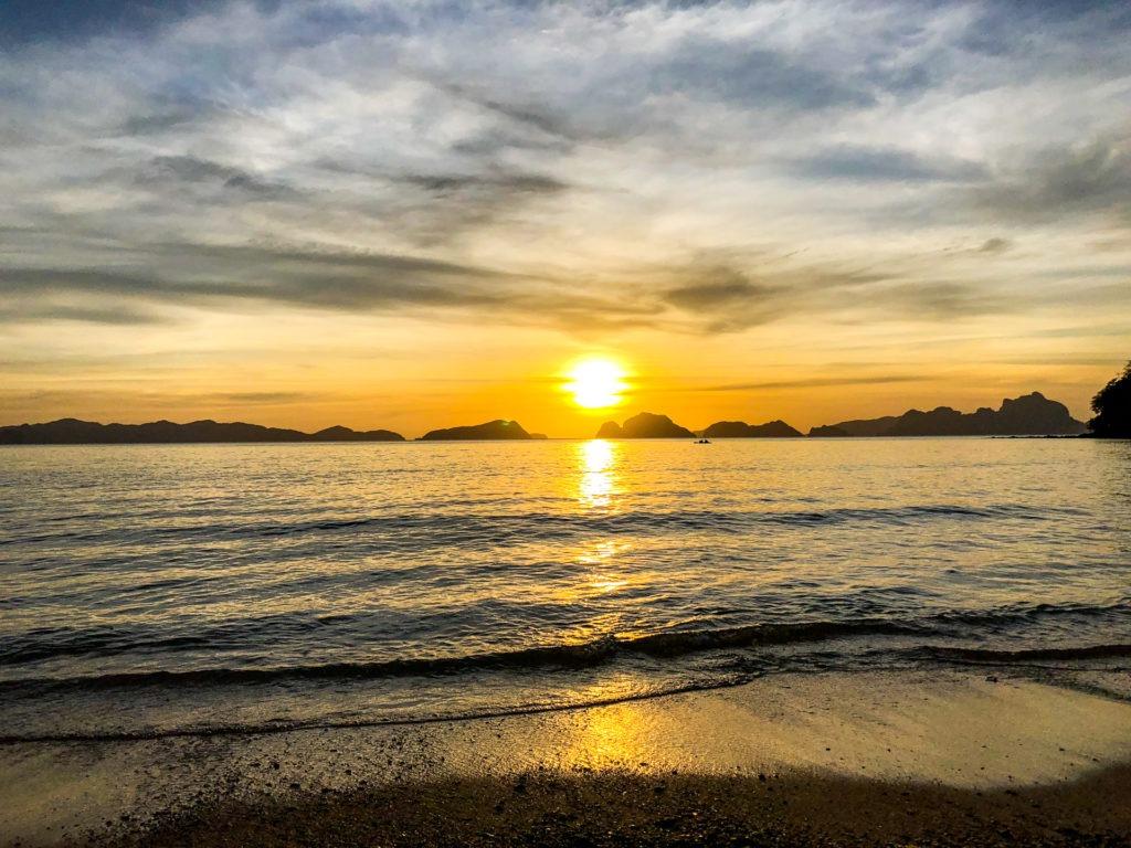 Sunset in Las Cabanas beach in El Nido, Palawan, Philippines