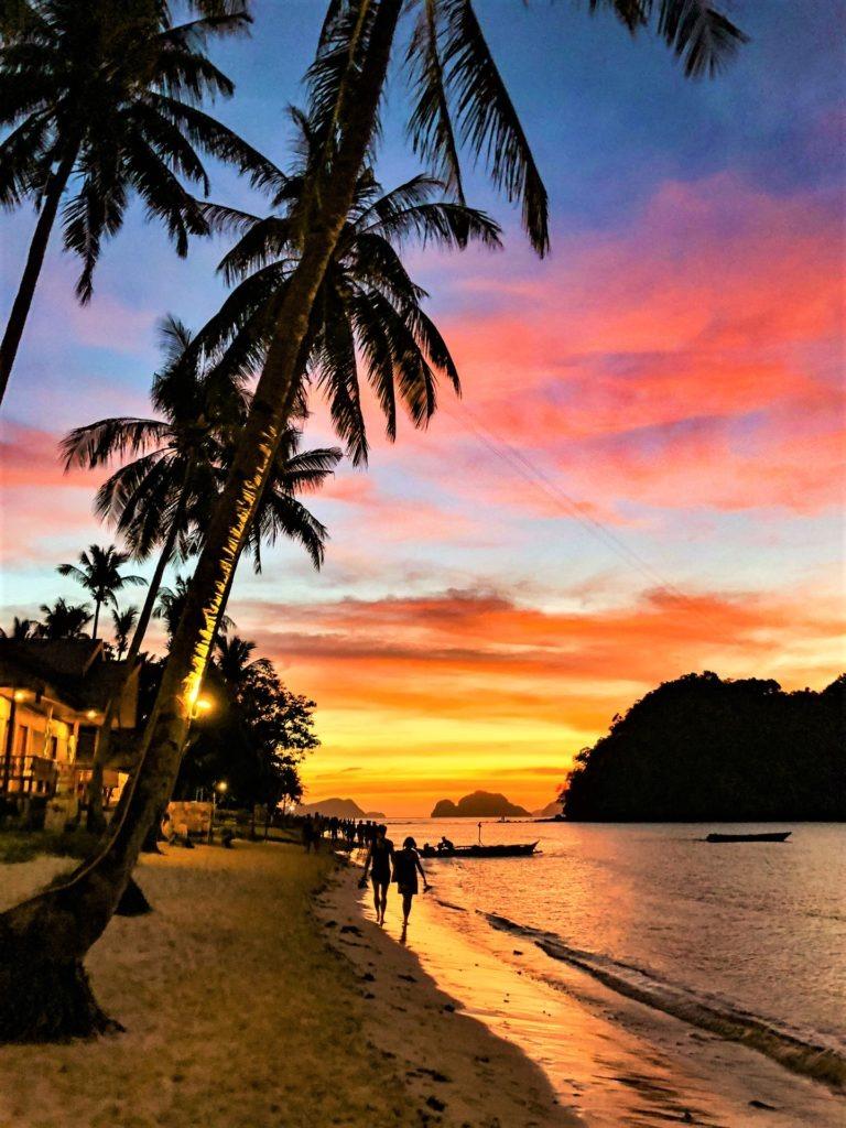 Amazing sunset at Las Cabanas beach, El Nido, Philippines